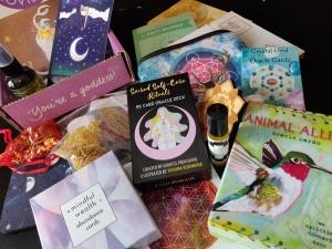 Goddess Box loot including oracle decks, dowsing kit, room spray, and beautiful postcards