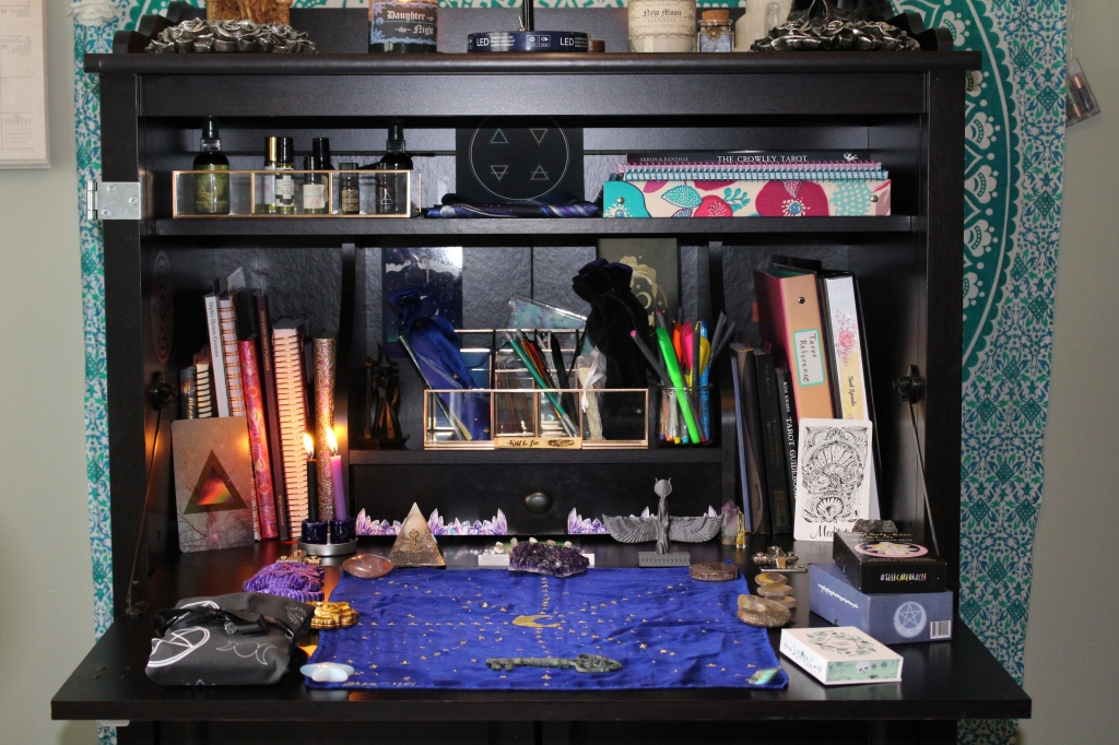 Armoire desk set up for Tarot and Lenormand card readings with crystals, candles, and Tarot cloth